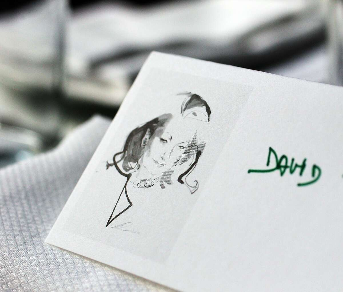 Stylish place cards grace the tables for the luncheon in honor of David Downton's new book , David Downton: Portraits of the Worlds Most Stylish Women, at The Cavalier, October 8, 2015.