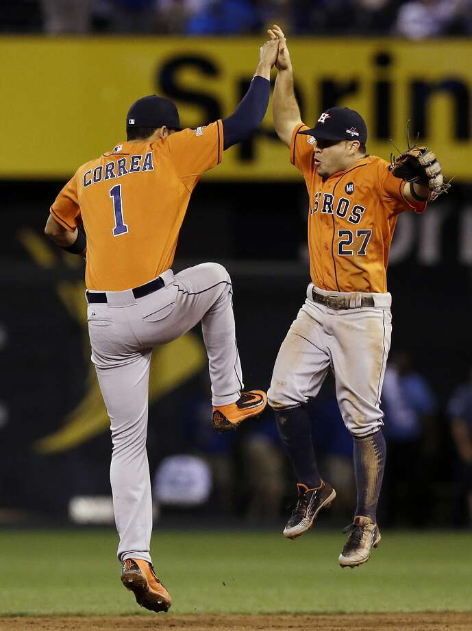 Houston middle infielders Carlos Correa and Jose Altuve do a victory dance after the final out of the Astros' Game 1 win. Photo: Orlin Wagner, Associated Press