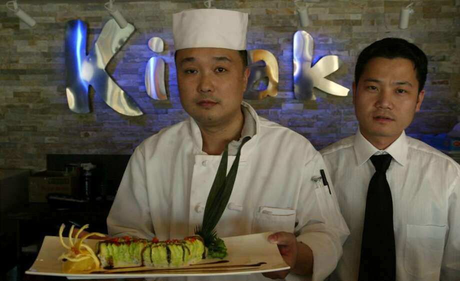 (L-R) Kevin Pan and Jimmy Pan have opened Kiraku Japanese and Asian Grill, Thursday, March 18, 2010, at 1795 Post Road. Photo: Phil Noel / Connecticut Post