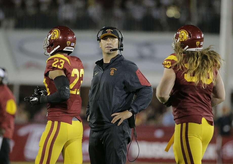 USC's Steve Sarkisian checks the scoreboard after a Washington touchdown. Photo: Jae C. Hong, Associated Press