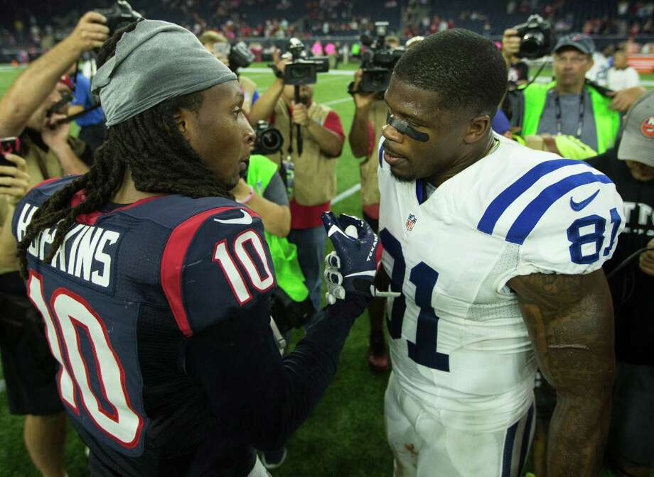 Texans wide receiver DeAndre Hopkins, left, reunites with ex-teammate Andre Johnson after Thursday's Colts victory at NRG Stadium. Photo: Brett Coomer, Staff / © 2015  Houston Chronicle