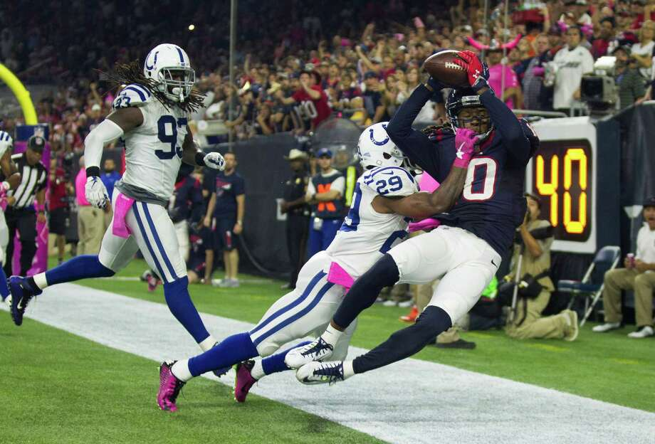 Although out of bounds on this play, Texans wide receiver DeAndre Hopkins, right, enjoyed a career game with 11 receptions for 169 yards in Thursday night's 27-20 loss to the Colts at NRG Stadium. Photo: Brett Coomer, Staff / © 2015  Houston Chronicle