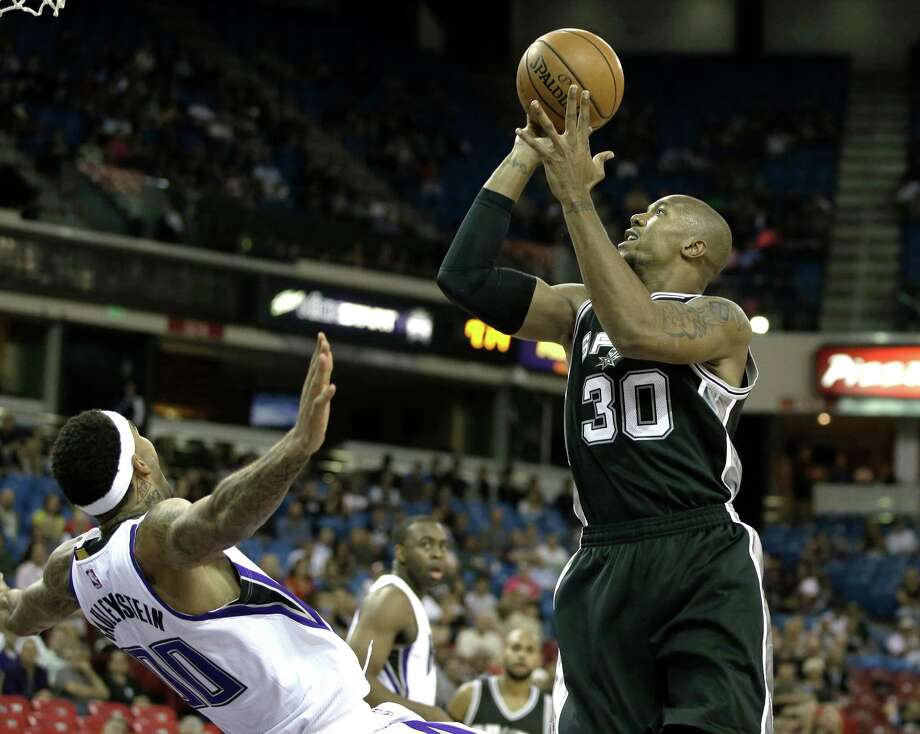 San Antonio Spurs forward David West, right, shoot over Sacramento Kings center Willie Cauley-Stein during the first quarter of an NBA preseason basketball game Thursday, Oct. 8, 2015, in Sacramento, Calif. (AP Photo/Rich Pedroncelli) Photo: Rich Pedroncelli, STF / Associated Press / AP