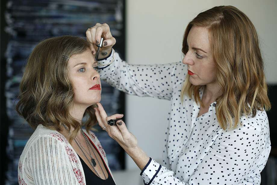 Eyebrow guru Michele McConnell works on the brows of Dalila Acuna in San Francisco, Calif., on Wednesday, October 7, 2015. Photo: Liz Hafalia, The Chronicle