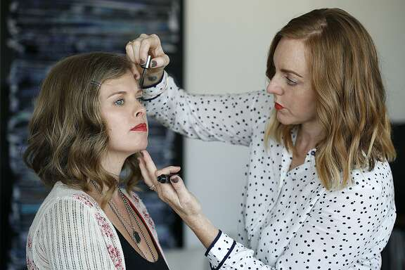 Eyebrow guru Michele McConnell works on the brows of Dalila Acuna in San Francisco, Calif., on Wednesday, October 7, 2015.