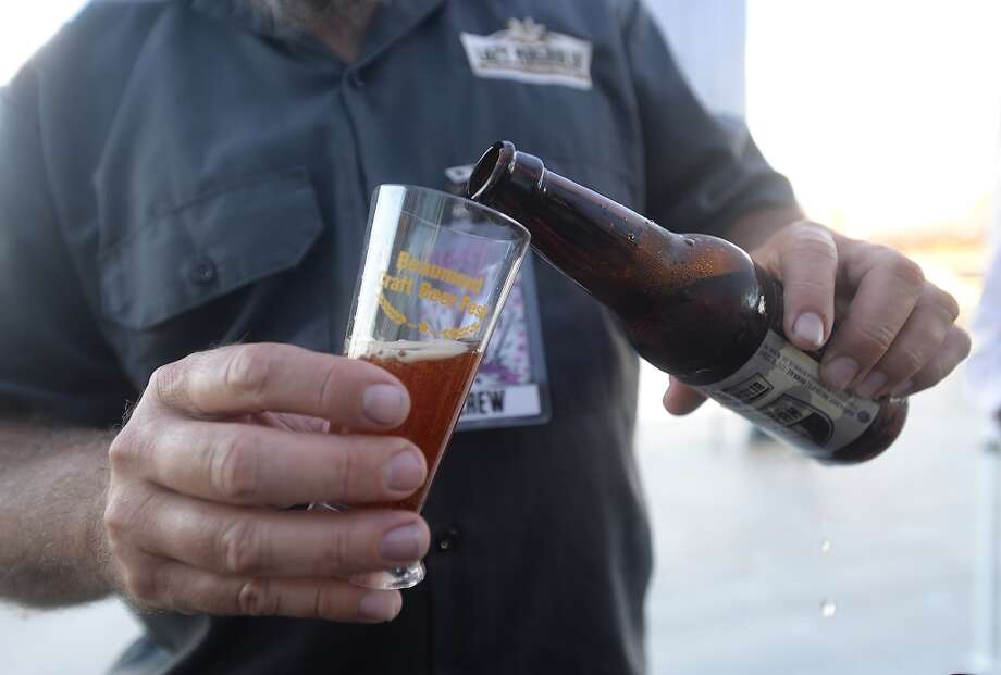 Brewery representatives keep the samples coming at the first Craft Beer Festival Saturday at the Event Centre. The City of Beaumont teamed up with local distributors Giglio and 2-Row to put on the event, which featured craft beers from over 30 breweries. Photo taken Saturday, September 19, 2015 Photo by Kim Brent