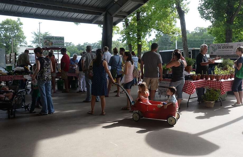 Customers fill the pavilion at the Beaumont Farmer's Market Saturday morning. As the growing season hits its peak for many fruits and vegetables, the crowd at the weekly market is hitting a peak of its own. Photo taken Saturday, May 30, 2015 Kim Brent/The Enterprise Photo: Kim Brent/The Enterprise