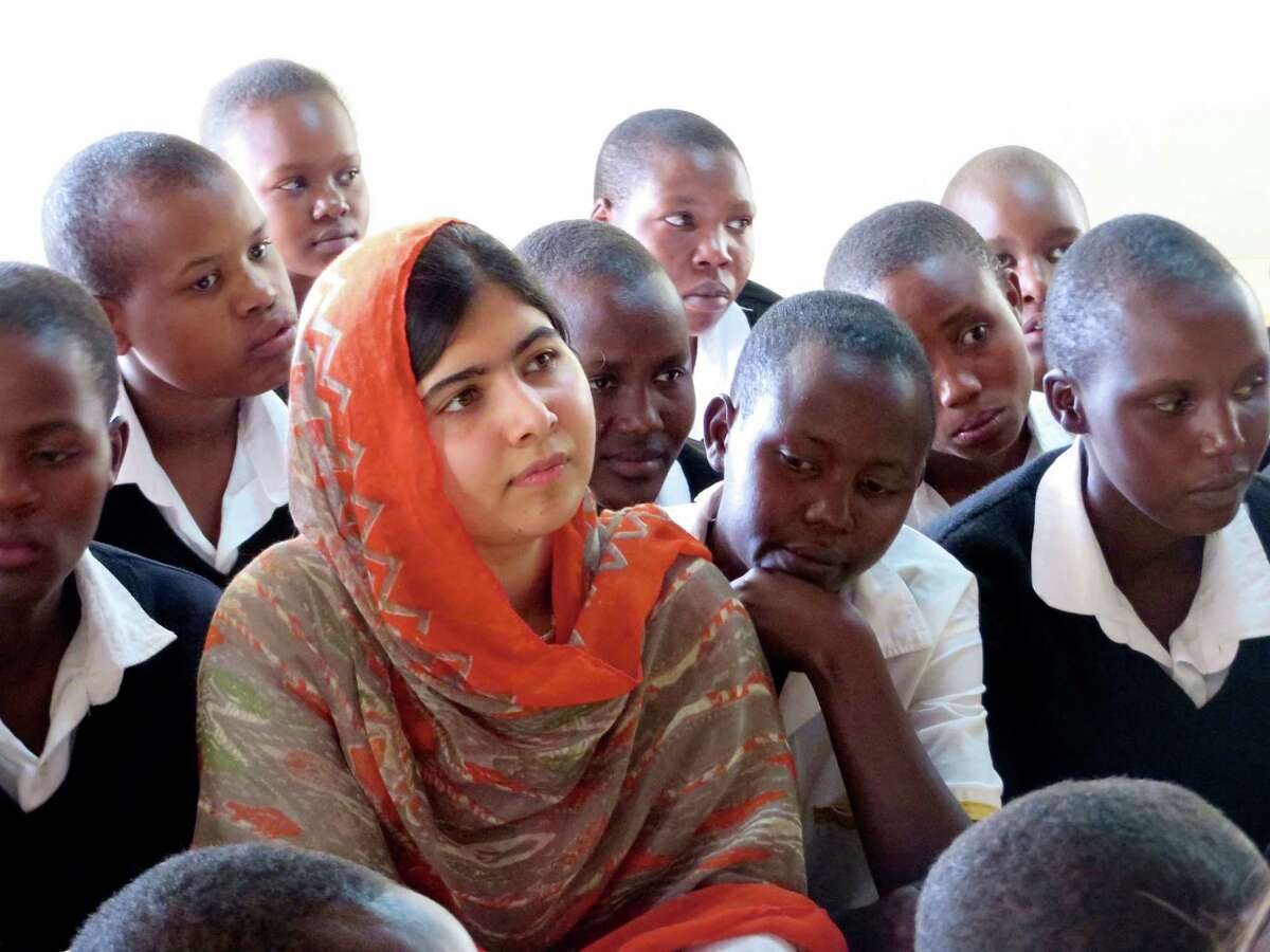This May 26, 2014 photo provided by courtesy of Fox Searchlight Pictures shows, Malala Yousafzai, second left, at the Kisaruni Girls School in Massai Mara, Kenya. Yousafzai is the subject of the documentary film,