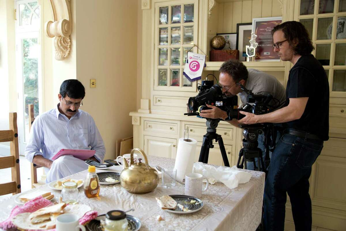 In this Dec. 17, 2013 photo released by Twentieth Century Fox Film Corporation, Zia Yousafzai, from left, director of photography Erich Roland and director Davis Guggenheim appear in Birmingham, England during the filming of the documentary,