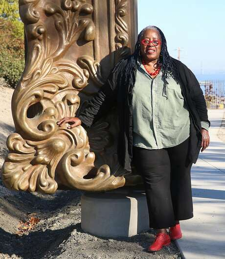 "Artist Mildred Howard shows ""Frame,"" her huge Rococo frame sculpture at the San Francisco Shipyard sculpture garden. Photo: Liz Hafalia, The Chronicle"