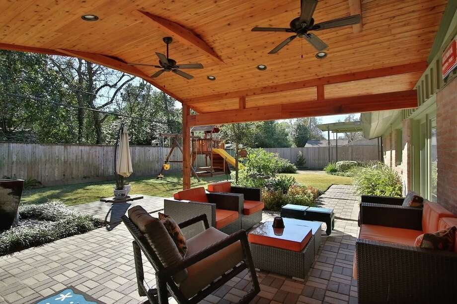 This outdoor space provides enjoyment for everyone. Photo: Remodelers Of Houston