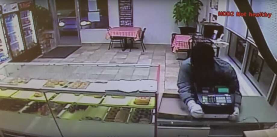 A off-duty Dallas police officer arrested one man in a doughnut shop robbery on Thursday morning. Photo: Screenshot Via YouTube/Dallas Police Department