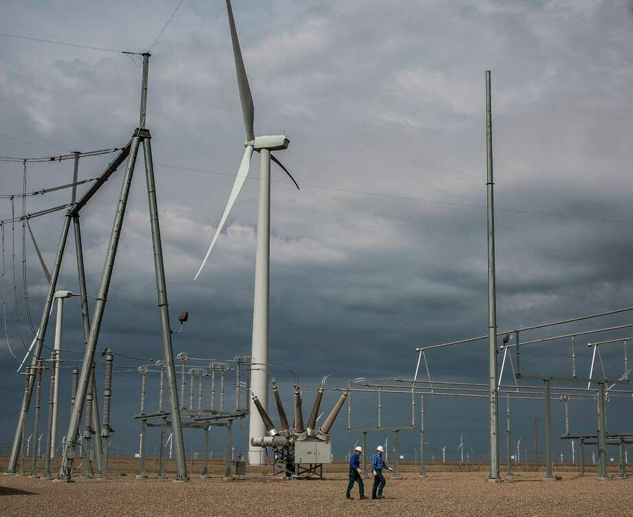 Pattern Energy Group facility manager Scott Creech, left, and assistant facility manager Spencer Roland, walk though the Panhandle Wind  Jack Ramey Substation.  Google is an investor in the project, which was finished late last year. (Michael Norris/for the Chronicle) Photo: Michael Norris, Freelance Photographer / {copyright}2015 Houston Chronicle2015 Houston Chronicle