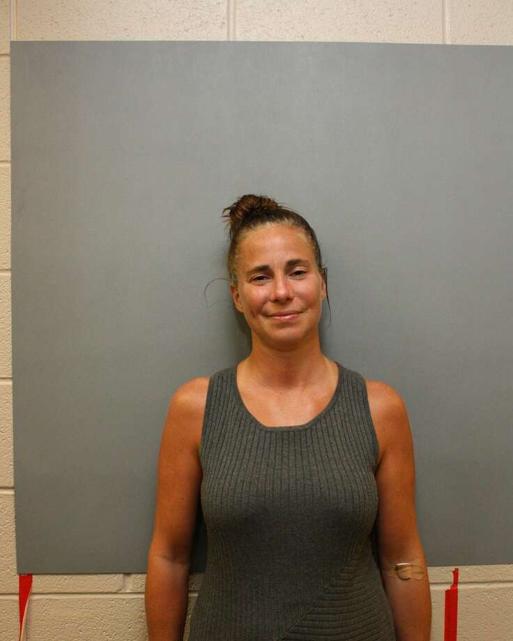 Deborah Vitt, 38, faces three felony charges after drunkenly crashing into another vehicle in a middle school drop-off line in Carrollton.
