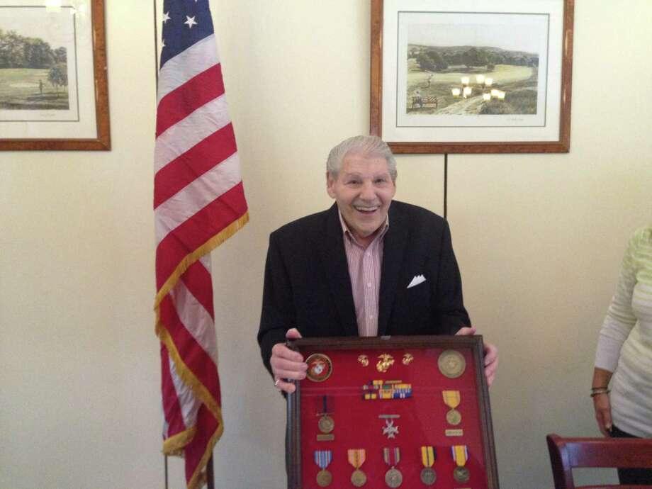 Retired U.S. Marine Corps Master Sergeant John Geas, a Stamford resident, receives his medals from U.S. Sen. Richard Blumenthal, D-Conn. Photo: Keila Torres Ocasio, Hearst Connecticut Media / Stamford Advocate