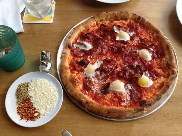 """Clark Cooper ConceptsCoppa OsteriaWhere:5210 Morningside  Photo: Coppa """"ham and egg"""" pizza made with spicy air-dried pork shoulder, tomato, parmesan and quail eggs Photo: Yelp/Mary O."""