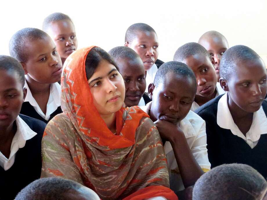 FILE-- Malala Yousafzai at the Kisaruni Girls School on May 26, 2014 in Massai Mara, Kenya.CEO Tim Cook and Malala Yousafzai have announced a long-term partnership that aims at getting 100,000 girls into education. Photo: Fox Searchlight Pictures, McClatchy-Tribune News Service
