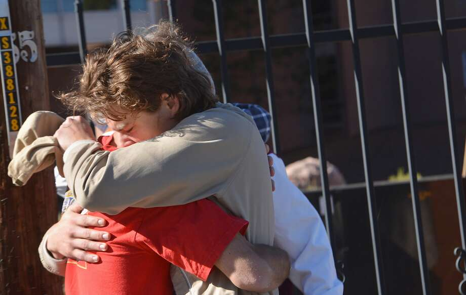 Two people embrace outside a Northern Arizona University student dormitory after the fatal campus shooting. Photo: Josh Biggs, Associated Press