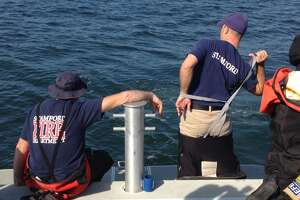 Stamford scuba divers, with assistance from Greenwich, respond to underwater vehicle - Photo