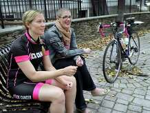 Jennifer Lynch, 37, left, is doing a 30-day fundraising bike ride to raise awareness and funds for breast cancer support. Her friend, Ericka Onorato, 38, of New Milford, right, a breast cancer patient, is her motivation. Photo Friday, Oct. 9, 2015.
