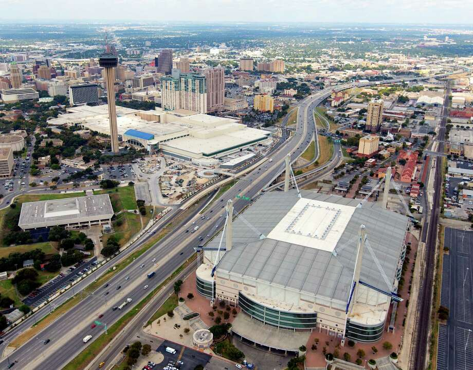 The Alamodome is seen in Thursday Oct. 8, 2015 aerial photo while recently-expanded Henry B. Gonzalez Convention Center is seen in the background along with the rest of downtown San Antonio. Photo: WILLIAM LUTHER, Staff / San Antonio Express-News / © 2015 San Antonio Express-News