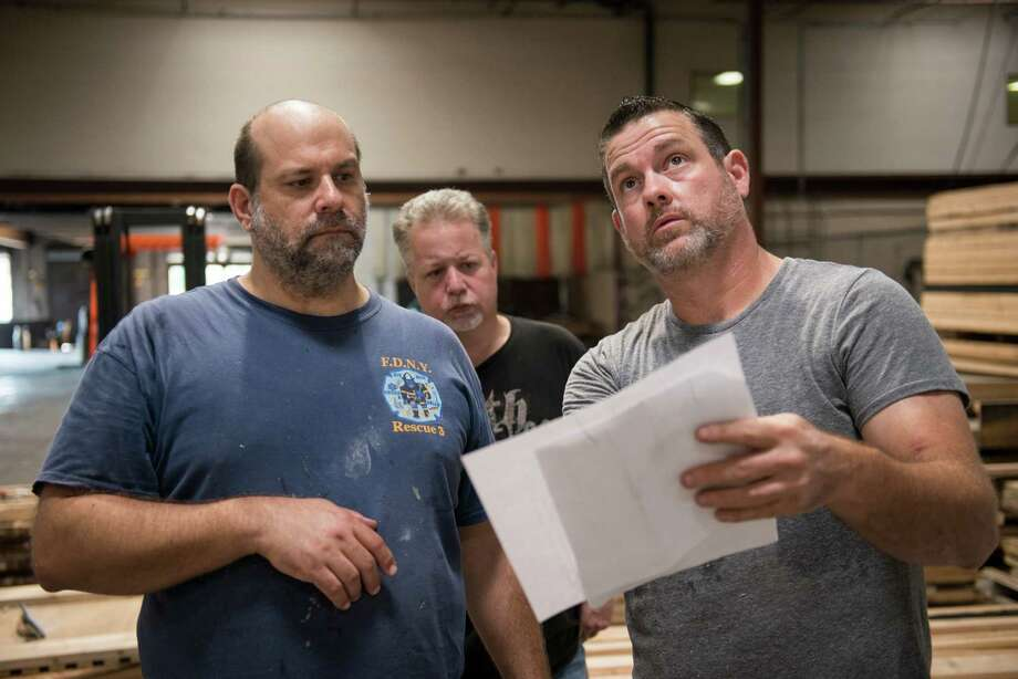 Partner in Thirteenth Floor Daniel McCullough, right, partner Greg Salyers, center, and builder Victor F. Morales, left, look at the drawings for a piece at the Thirteenth Floor production house in East San Antonio on Thursday, October 1, 2015. The team is working on a mausoleum based on the Dexter Mausoleum in Ohio that they will take to the International Association of Amusement Parks expo in Orlando this November. The Thirteenth Floor Entertainment Group generally produces 8 to 10 pieces a year, primarily for in-house uses at their haunted houses and great room escape locations throughout the U.S. Each haunted house boasts different attractions and all of the pieces from sculptures to entire structures are built in their production facility. Photo: Photos By Matthew Busch / For The San Antonio Express-News / © Matthew Busch