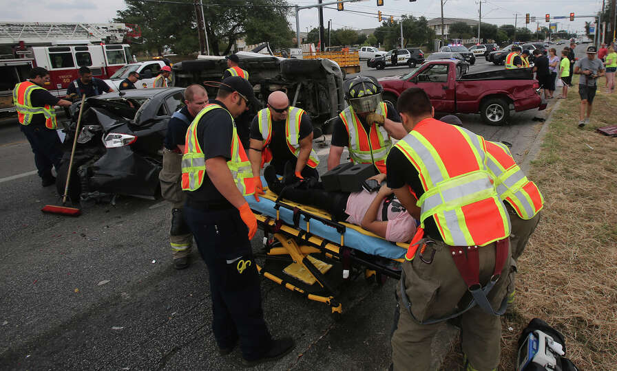 San Antonio EMS paramedics and police work Friday October 9, 2015 at the scene of a four-vehicle maj