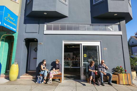 (l-r) Juliana Gallin sits with Carolyn Martone and Liz Vanderburgh eats with Richard Domman outside the new bakery Pinkie's in San Francisco, California on October 9, 2015. In 2010 only about 7 percent of Bernal Heights houses were over $1 million and now it is over 80%.