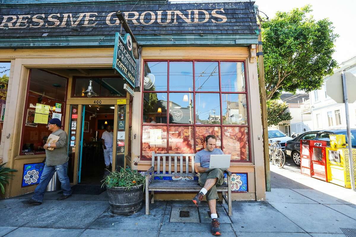 Chris Baldwin (right), of Conveyance PR sits outside Progressive Grounds coffee shop, while working on his computer, in Bernal Heights, San Francisco, California on October 9, 2015.
