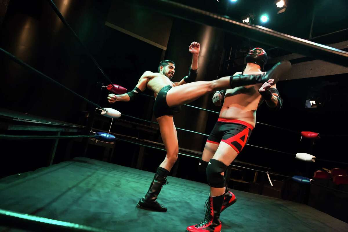 """Herman Gambhir and Luis Galindo (masked) in """"The Elaborate Entrance of Chad Deity"""" at Stages."""