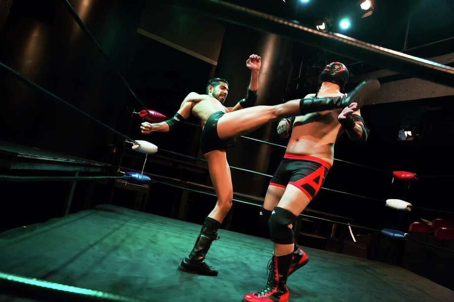 """Herman Gambhir and Luis Galindo (masked) in """"The Elaborate Entrance of Chad Deity"""" at Stages. Photo: Amitava Sarkar"""
