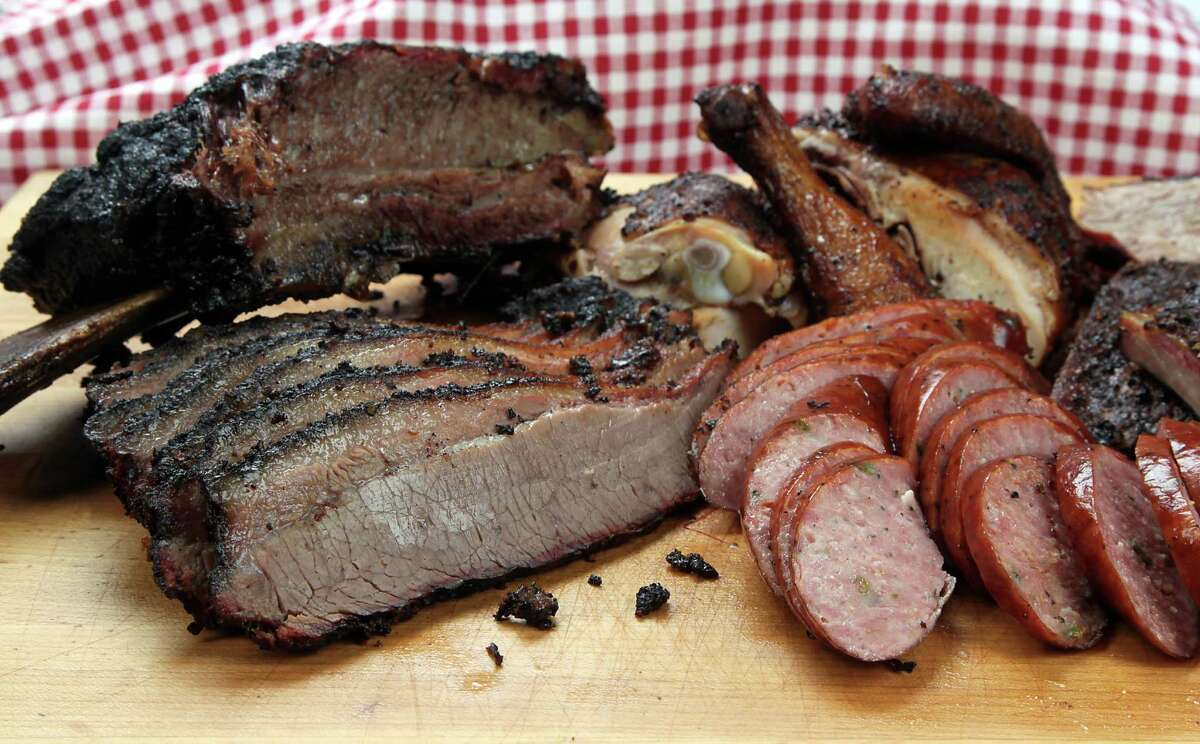Barbecue brisket, sausage, chicken and beef rib from The Brisket House restaurant in Houston. ( James Nielsen / Houston Chronicle )