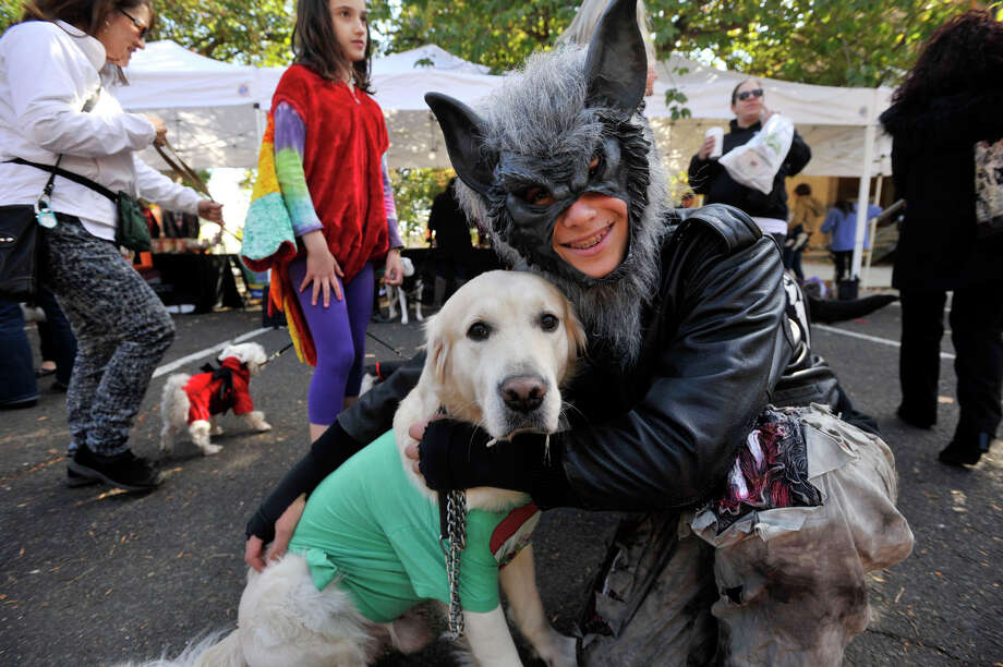 Or be hugged while they're wearing costumes. Photo: Jason Rearick, Staff Photographer / Stamford Advocate