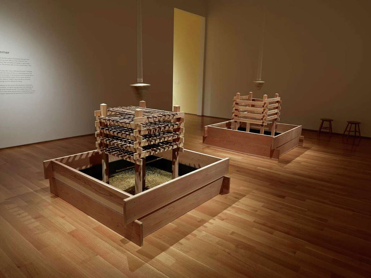 """Mineko Grimmer's """"Dialogue"""" contains a pair of sound sculptures that play as coral pebbles drop from above. The pebbles are suspended in triangular blocks of ice that are replaced twice daily."""
