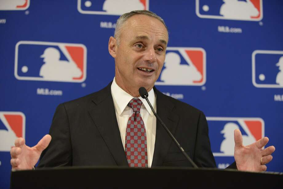 "FILE - In this Aug. 13, 2015, file photo, Major League Baseball Commissioner Rob Manfred speaks to the media after the owners meetings in Chicago. Manfred says it's ""not appropriate"" to enforce pace-of-play rules as strictly during the postseason. Speaking before Toronto hosted Texas in Game 2 of their AL Division Series, Manfred said he was pleased with cooperation from players during the regular season, when the average time of a nine-inning game was cut by six minutes this year to 2:56. (AP Photo/Paul Beaty, File) Photo: Paul Beaty, Associated Press"