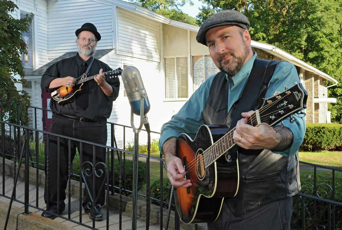 Musicians Michael Eck, left, and Tom Lindsay at Hamilton Union Presbyterian Church on Wednesday, Oct. 7, 2015 in Guilderland, N.Y. The duo called Lost Radio Rounders will perform at the Hamilton Union Church on Friday, Oct. 16. (Lori Van Buren / Times Union)