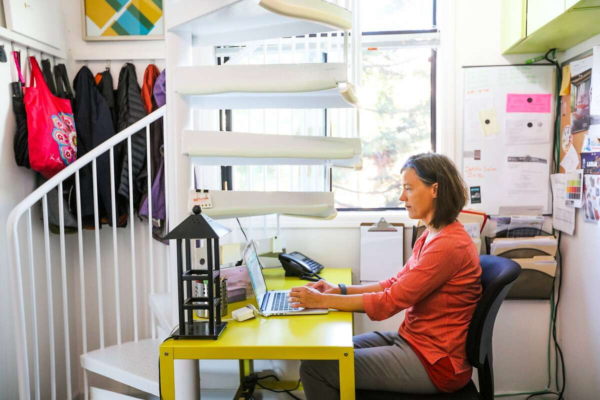 Jennifer Ott, an interior designer, sits at her desk, under the stairs of her house in Bernal Heights, San Francisco, California on October 9, 2015. The house, purchased for under a million dollars is a fixer upper.