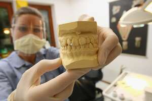 Co-workers call dental technician a 'witch'; she's fired - Photo