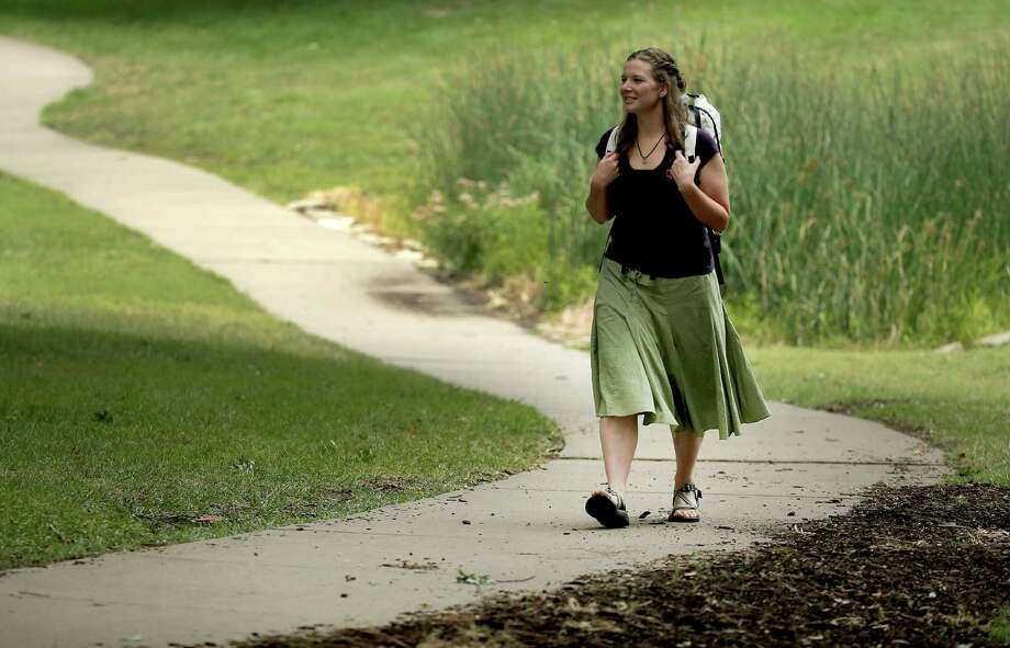 In this photo taken Aug. 28, 2015, Bethany Hughes walks through a park in Kansas City, Mo., as she prepares for her upcoming hike through the Americas. Photo: Charlie Riedel /Associated Press / AP