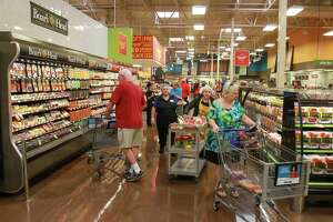 Shoppers in the Deli department in the new Katy Kroger Marketplace, which opened today at 1712 Spring Green Blvd. in Katy.  (For the Chronicle/Gary Fountain, October 9, 2015)