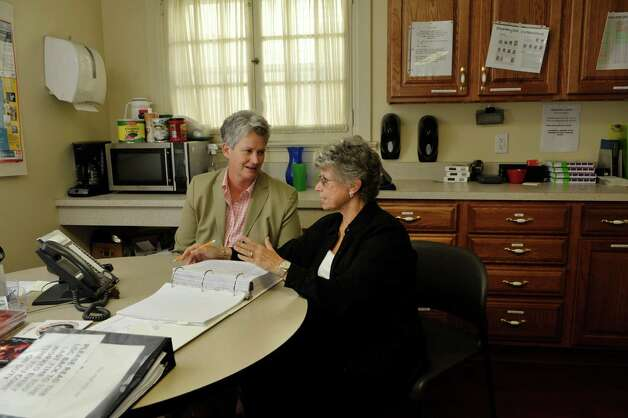 Sherri Roff, left, PhD, LMSW, CASAC, clinical director for The Next Step and Marsha Nadell Penrose, LMSW, executive director of The Next Step, talk about a case at The Next Step on Thursday, Oct. 8, 2015, in Albany, N.Y.   (Paul Buckowski / Times Union) Photo: PAUL BUCKOWSKI / 10033645A