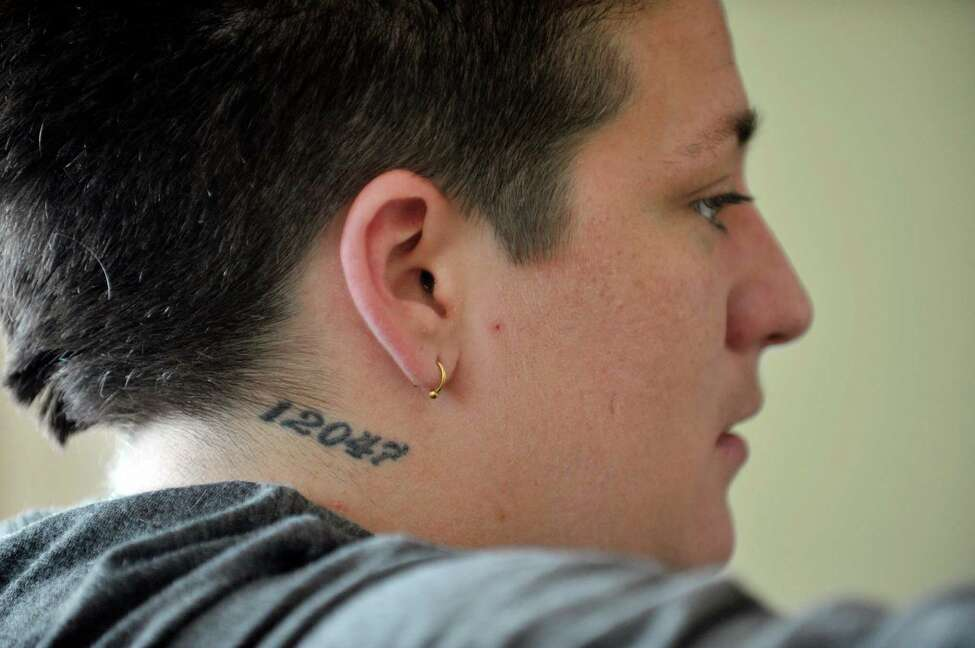 Ashley Radliff, a recovering heroin user, talks about her life during an interview at The Next Step program on Monday, Sept. 28, 2015, in Albany, N.Y. Radliff grew up in Cohoes and has a tattoo of the zip code of the city. (Paul Buckowski / Times Union)