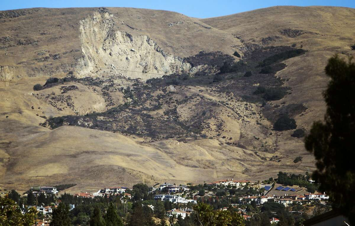 Homes and other structures are seen below the remains of a landslide in 1998 during that year's El Nino in Fremont.