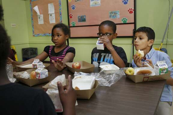 From left, Ciara Simpson, 8, Leah Seymore, 7, Jordan Hargrove, 8 and Saeed Shariff, 8, eat lunch together at Lafayette Elementary School Oct. 9 2015 in Oakland, Calif.