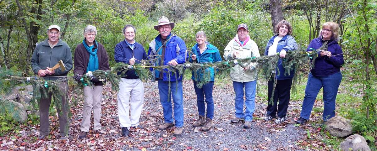 More than 100 people recently attended the Kinderhook Creek Nature Preserve evergreen garland cutting ceremony. The 73-acre preserve at 300 Martha Hicks Road in Nassau was created from land donations from four neighbors: David and Lucy Gaskell, Bob and Jennifer Newton, the late Kenneth York, and the Edward W. Golden Foundation. It has over ½ mile of river frontage, steep hills, trails, mature forest and wildlife habitat. There is no charge to visit, and Rensselaer Land Trust welcomes the public for fishing, winter recreation, horseback riding and nature study. For more information, go to http://www.renstrust.org (Allan Stern)