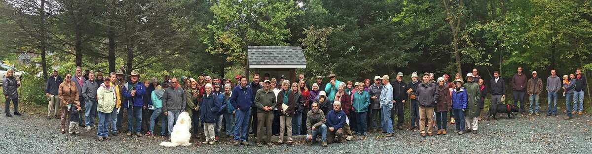 Over 100 people attended the Kinderhook Creek Nature Preserve evergreen garland cutting ceremony including Mike Moore from the Governors Office, David Fleming, Jr. Supervisor for the Town of Nassau, and Mitch Levinn Mayor for the Village of East Nassau. The 73 acre nature preserve was created from land donations from four neighbors: David and Lucy Gaskell, Bob and Jennifer Newton, the late Kenneth York, and the Edward W. Golden Foundation. The new preserve has over ½ mile of river frontage, steep hills, trails, mature forest, and wildlife habitat. There is no charge to visit the preserve. For more information see: http://www.renstrust.org (Allan Stern)