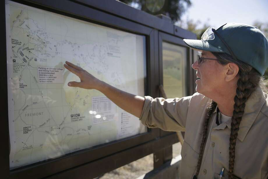 Marie Reil, a park ranger East Bay Regional Park District, points out the location of the remains of a landslide from the 1998 El Nino in Fremont. Photo: Lea Suzuki, The Chronicle