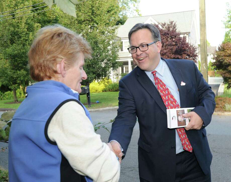 At right, Frank Farricker, Democratic candidate for Greenwich first selectman, shakes hands with Meredith Sampson, while campaigning in Old Greenwich, Conn., Thursday, Oct. 8, 2015. Photo: Bob Luckey Jr. / Hearst Connecticut Media / Greenwich Time