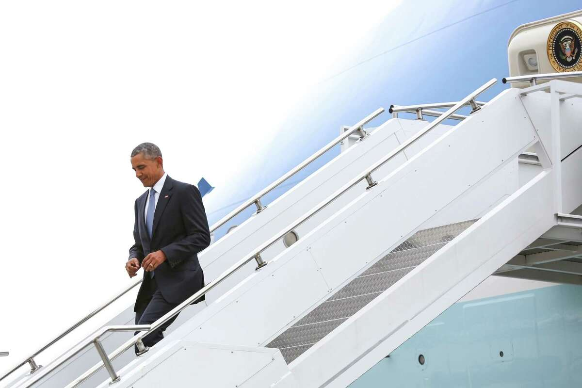 President Barack Obama deplanes Air Force One at Boeing Field during a brief visit to Seattle.