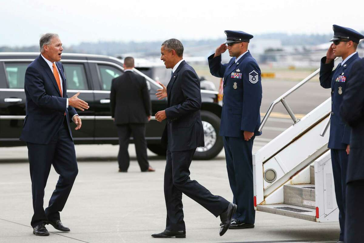 President Barack Obama is greeted by Washington Gov. Jay Inslee during a brief visit to Seattle.